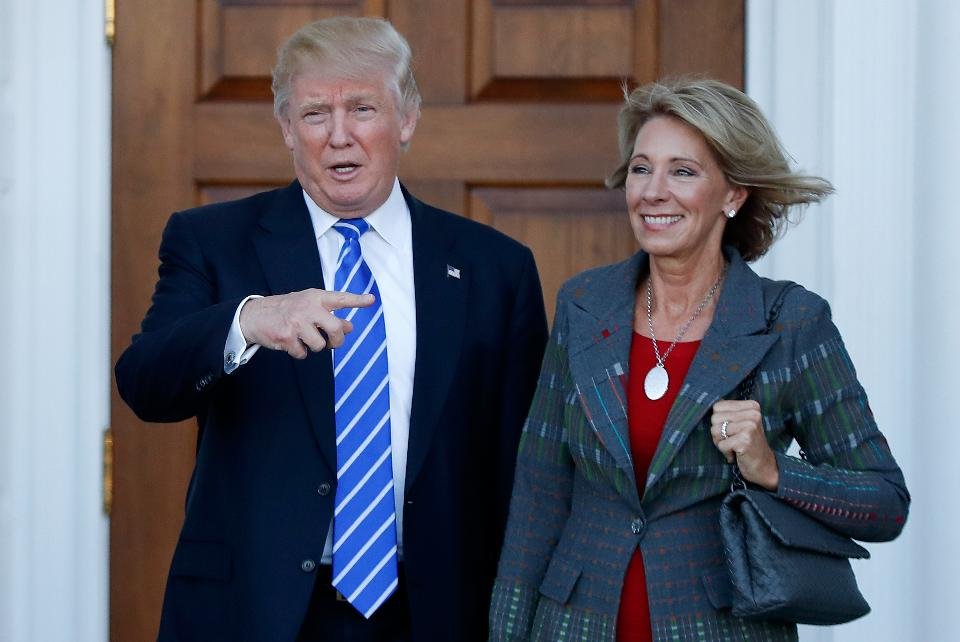 President Donald J. Trump walks side by side with Secretary of Education, Betsy DeVos. The senate confirmed DeVos to the post after Vice President Mike Pence broke the Senate deadlock with his vote to confirm her nomination.
