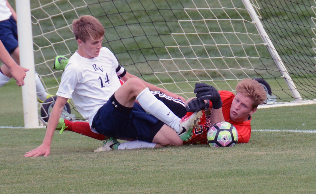 Junior+Sam+Keller+making+a+dive+against+Arapahoe+keeper+