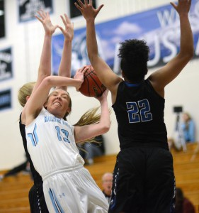 Ralston Valley senior Delaynie Byrne ('18) battles inside during the Mustangs season-opening setback against Grandview, the top-ranked team in Colorado and the defending Class 5A state champions. Byrne led RV with 26 points in the game.
